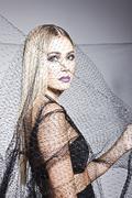 Elegant woman with a veil - stock photo