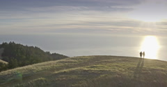Aerial drone view flying over two people walking on a hill in San Francisco Stock Footage