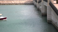 Boat navigates in the marina in residential area of The Pearl Qatar, close to Do Stock Footage