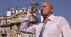 Bank Employee Outside Office Building Fieldwork Hydrate Drink Water Street View Stock Footage