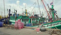 Songkhla (Thailand) pier and moored fishing boats Stock Footage