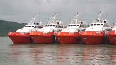 Moored red boats at Songkhla pier. Close up shot Stock Footage