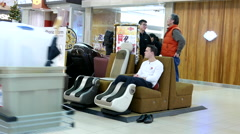 One side of people shopping and resting at massage chair Stock Footage