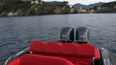 Red sofa at the stern of a rubber boat  Stock Footage