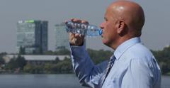 Business Town Center Sales Meeting Company Thirsty Manager Hydrate Drink Water - stock footage