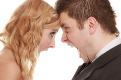 Angry woman man yelling at each other. Fury bride groom. - stock photo