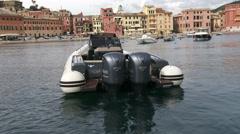 Rubber boat docked in Silence bay in Sestri Levante  - stock footage