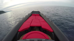 Red sofa on the bow of a rubber boat  Stock Footage