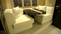 Breakfast table in main cabin of a luxury yacht  Stock Footage