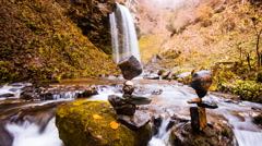 Time Lapse - Small river in fall with a stone sculpture Stock Footage