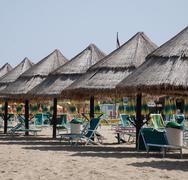 Palm Leaf Beach Umbrellas Stock Photos