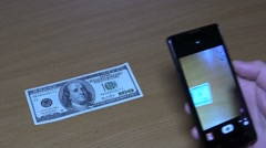 Phone clones banknotes of dollars. Trick. Stock Footage