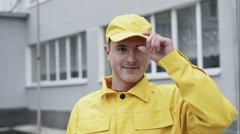 Happy Worker in yellow workwear - stock footage