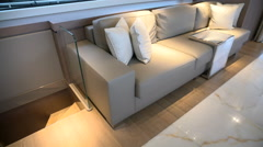 Sofa with coffee table beside stairs on a luxury yacht  Stock Footage
