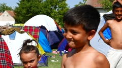 Refugee children play close to the border of Serbia in Tovarnik Stock Footage