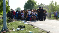Police guarding the tip of the waiting line of Refugees in Tovarnik Stock Footage