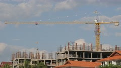 Crane bringing cement for construction hotel,Vang Vieng,Laos Stock Footage