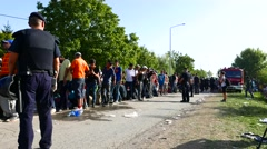 Police guarding the waiting line of Refugees in Tovarnik Stock Footage