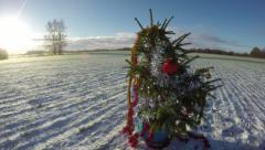 Sunset over the snowy field with Christmas tree, time lapse 4K Stock Footage