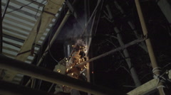 Welder is welding steel frame in factory Stock Footage
