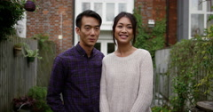 Married couple get a key to their new home. Shot on RED Epic. Stock Footage