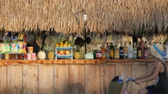 Thatched roof bar at Nam Song river,Vang Vieng,Laos Stock Footage