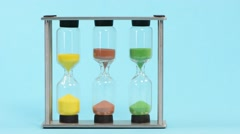 Time measurement with sand flowing through sandglasses Stock Footage