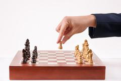 Person making first chess move - stock photo