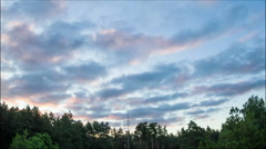 Sunrise, Clouds in a Sky Moving Above the Trees Stock Footage