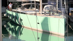 Sailing boat docked during Genoa Boat Show Stock Footage