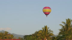 Hot air balloon drifting over landscape,Vang Vieng,Laos Stock Footage