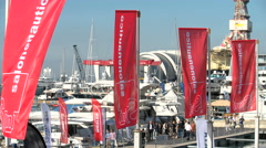 Flags waving during Genoa Boat Show Stock Footage