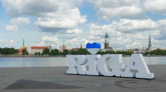 Stock Video Footage of Riga sign, majestic clouds, city view, timelapse, zoom in, 4k
