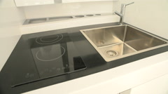 Sink and induction hob on a boat Stock Footage