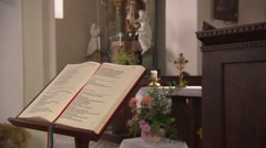 Prayer book in Catholic chapel Stock Footage