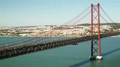 Sunny wide shot of Ponte 25 de Abril, Lisbon Stock Footage