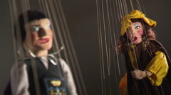 Couple of string puppets (rack focus) - stock footage