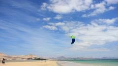 Kitesurfer go on a beach on Fuerteventura Canary Islands Stock Footage