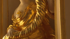 Golden baroque statue (tilt shot) Stock Footage