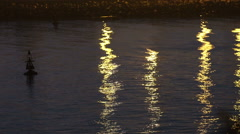 Shot of a buoy and reflectiong lights in water of a harbour. Stock Footage