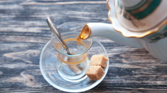 Pouring cup of tea slow motion Stock Footage