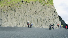 Time lapse People on Reynisfjara beach at south coast of Iceland at daytime Stock Footage