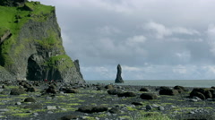 Time lapse man walking on Reynisfjara beach at south coast of Iceland at daytime Stock Footage