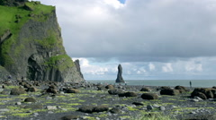 Tourists walking on Reynisfjara beach at south coast of Iceland at daytime Stock Footage