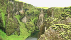 View of the magnificent Fjadrargljufur canyon and river running inside Timelapse Stock Footage
