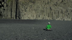 Boy play on Reynisfjara beach at south coast of Iceland, slow motion at 204fps Stock Footage