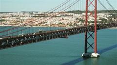 Sunny medium shot of Ponte 25 de Abril, Lisbon Stock Footage