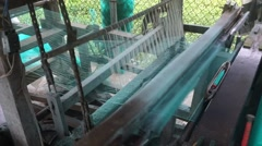 Stock Video Footage of Not recognizable man works at weaving loom making mosquito net