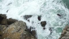 Big splash of wave hitting the cliff in slow motion, Top View Stock Footage