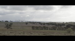 High voltage power lines running across the landscape Stock Footage